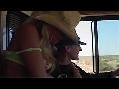 She stands in the dessert and stop a bus - she stand inside the bus and she can´t stop what happens
