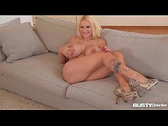 Busty seduction Dolly Fox fingers her shaved pussy during sexy interview