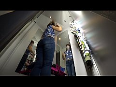 A hidden camera in a public dressing room caught a long-legged girl with a juicy ass, spying.