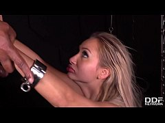 Submissive blondie Lara Onyx in chains double penetrated by two gentlemen