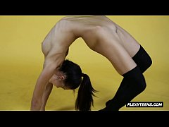 Talented naked gymnast in stockings