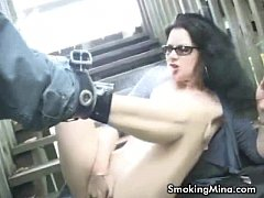Horny brunette fingering her pussy while smokin...