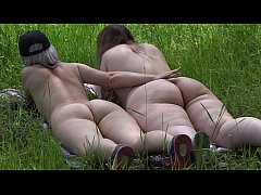 Two fat booty rest in the clearing by the river, and the voyeur spies on them. Pleasant petting lesbian nudist.