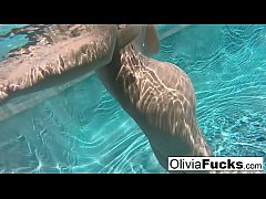 Horny Olivia Austin plays with her pussy underwater