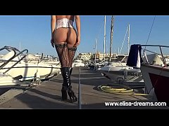 Sexy Pirate Elisa showing her buttplut outdoors