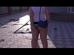 BBW is walking around the garden with an anal sex toy in a big ass.