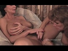 2 mature woman getting...
