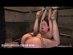Tied redhead babe gives...