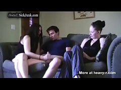 Girl jerks guy off to big cumshot while her fri...