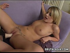 Asian babe fucking her girlfriend with a strap-on hard