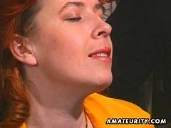 Redhead amateur Milf sucks and fucks with facia...