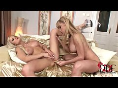 Hot young lesbian blondes kissing and loving each other