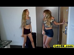 Horny blonde lesbians having fun with a strapon