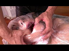 Submissive Leyla Black wraped in plastic and st...