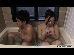 Couple has a bath together with a huge boner in it