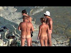 Cute young teen nudists on the beach
