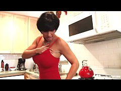 Astonishing mature with big knockers wears pantyhose and high heels in the kitchen.