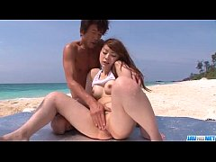 Mayuka Akimoto loves dealing two cocks at the beach