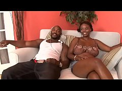 Sexy ebony with big boobs moans with pleasure while fit stud nails her on the sofa