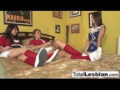 Three attractive schoolgirls engage in hot lesbian action