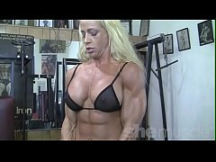 Blonde Female Bodybuilder in See Thru Top Works Out Hard