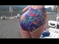 BBW with big booty in tight jeans is dressing i...
