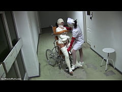 Patient in Wheelchair with Broken Legs and Stra...