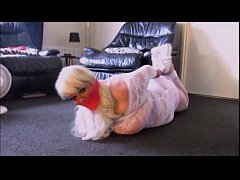 Hogtied and wrap gagged.