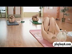 Hot women and trainer hot yoga session while al...