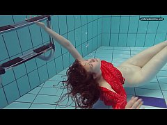 Red Dressed teen swimming...