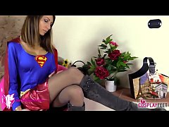 Supergirl in pantyhose takes boots off: worship her feet!
