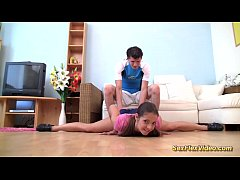 Teen gymnast stretched for...