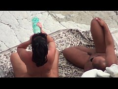 At a public beach man share his wife with a str...