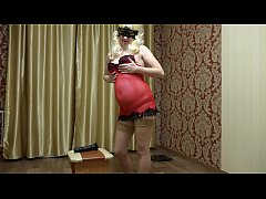 The blonde with a pregnant tummy in a red peignoir fucks hairy pussy to orgasm.