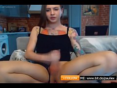 Petite woman with dick, tattoos and a toy in her ass