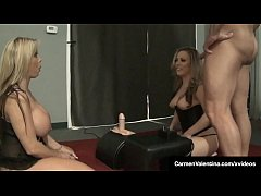 Blonde superstar Carmen Valentina & busty milf Amber Lynn Bach take turns straddling a sybian while at a convention, using their amazing vaginal muscles to clench their horny pussies tight around this mechanical cock!