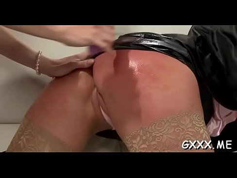 Mature lesbian gets her fascinating cunt toyed with a big fake penis