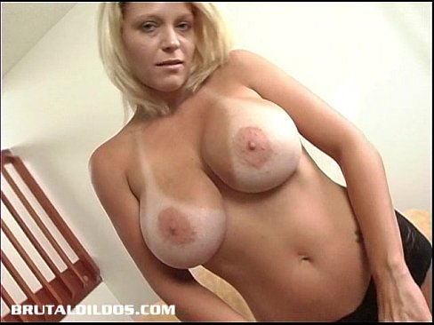 Busty babe with a big black dildo