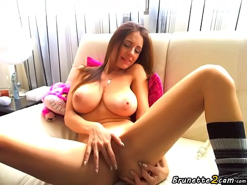 Busty putting a dildo in the pussy