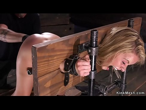 Bent over blonde in stock gets fisted