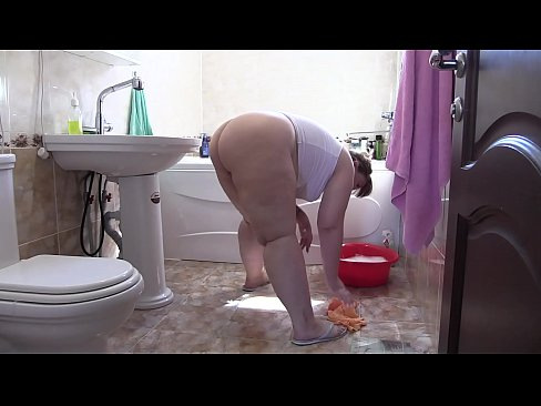 Hidden camera in the bathroom spy on big booty. A beautiful BBW without panties does the cleaning. Homemade fetish.