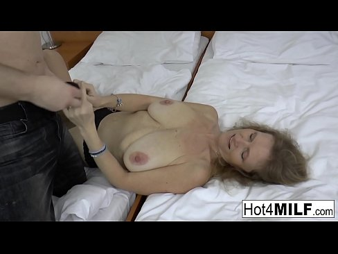 Blonde mature gets her big natural tits covered in cum