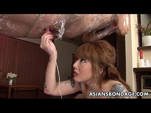BDSM fun with a girl bound and wrapped in plastic foil