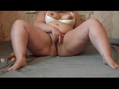 the girl masturbates her pussy with her fingers and various sex toys