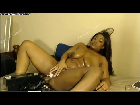 Ebony fucking a machine