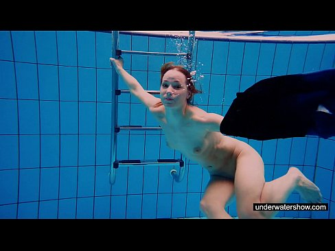 Young chick Avenna swimming naked in the pool