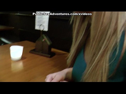 Blonde girl showing tits in the cafe