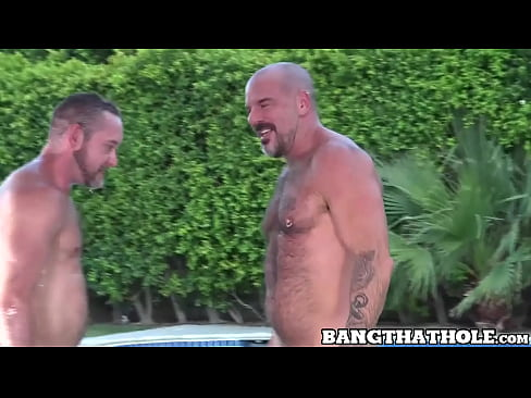 Two studs have rough and intense sex next to the pool