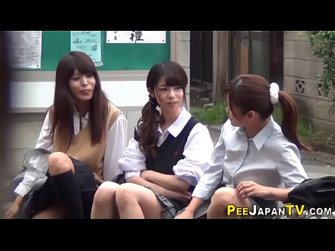 Pissing japanese teenagers get watched
