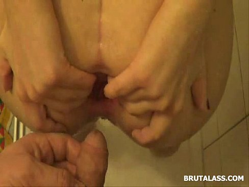 Amatuer brunette fills her ass with a big dildo and piss